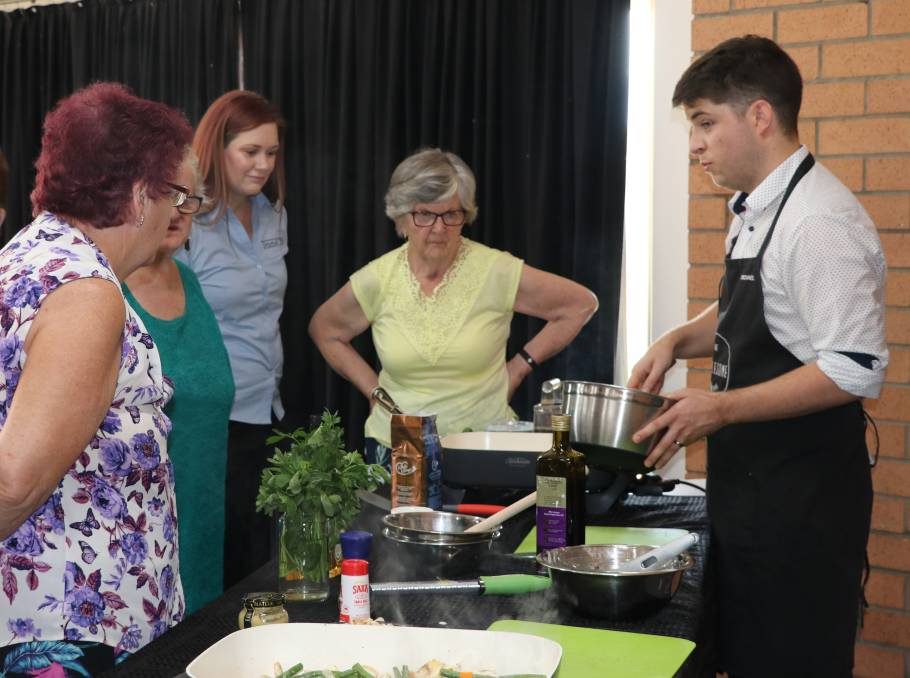 Delicious nutrition: The Wholesome Collective's Michael Paterson demonstrates some healthy recipes at one of the popular cooking workshops.